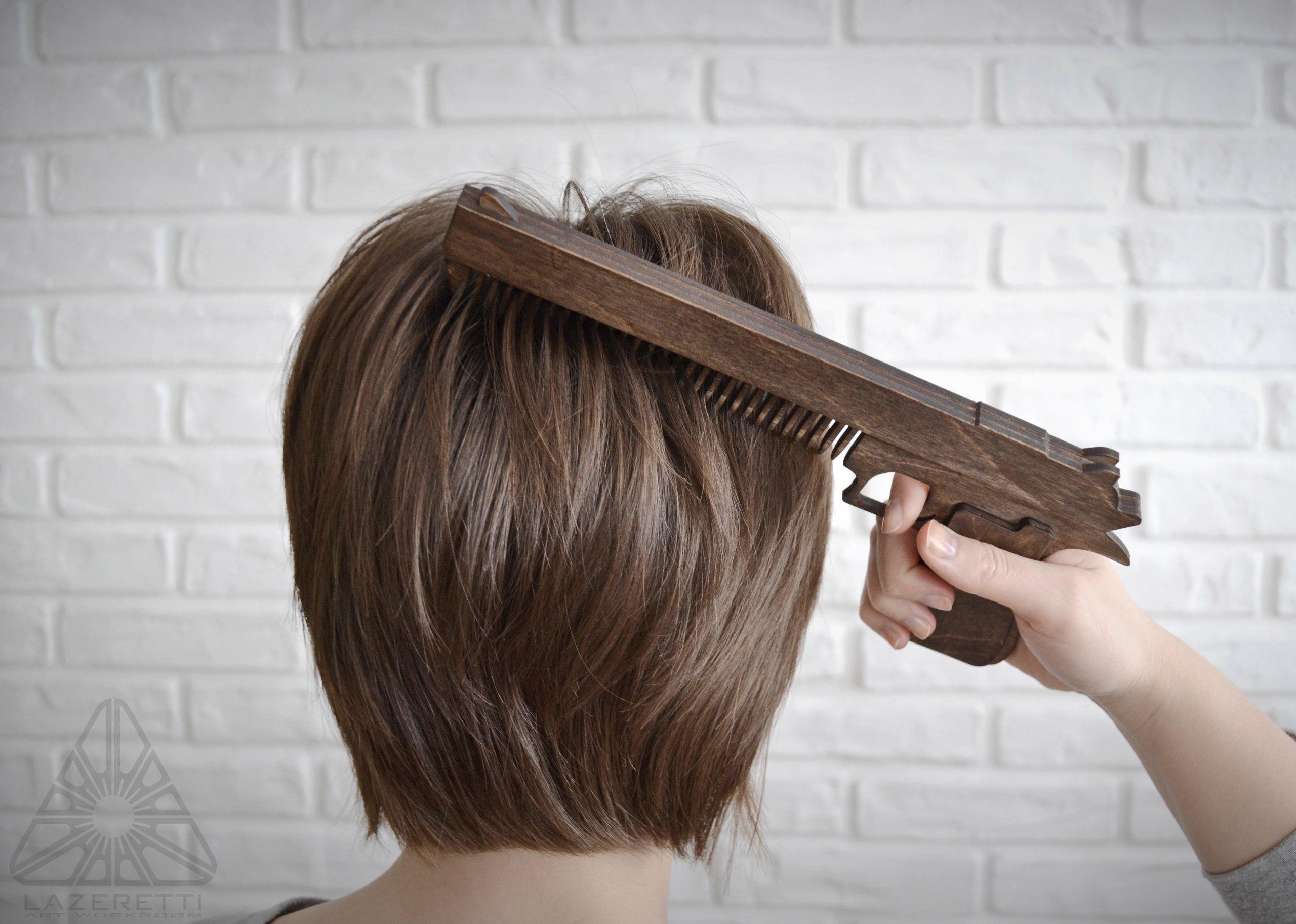 Laser Cut Gun Hair Comb Free Vector