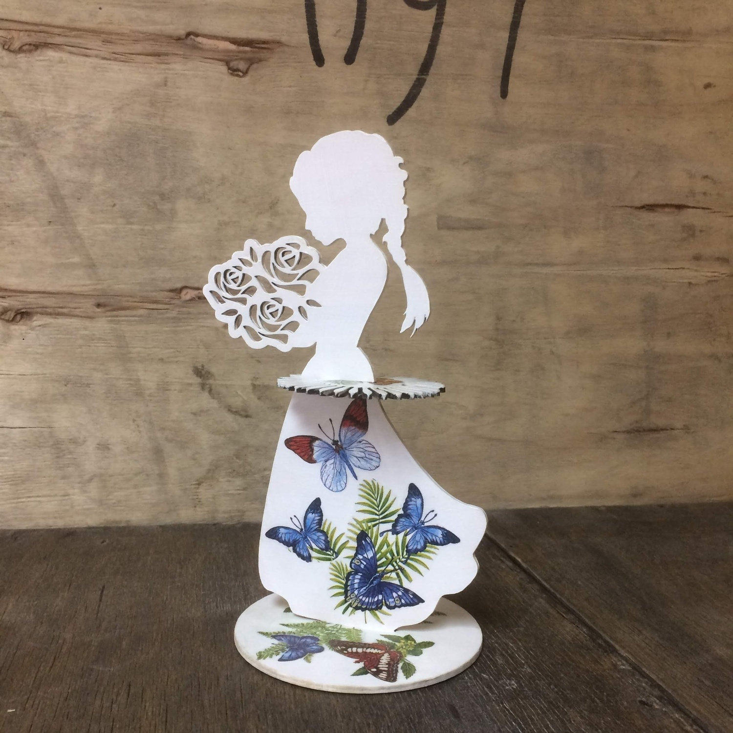 Laser Cut Girl With Bouquet Of Flowers Napkin Holder Free Vector