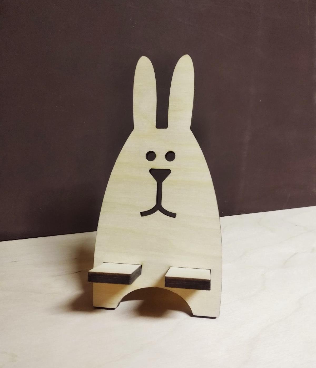 Laser Cut Creative Cute Rabbit Desktop Phone Stand Free Vector