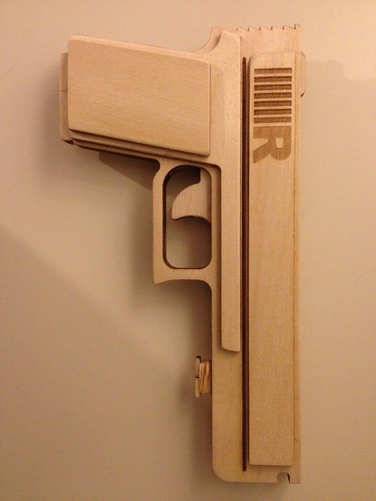 Laser Cut Semiautomatic Rubber Band Gun Free Vector