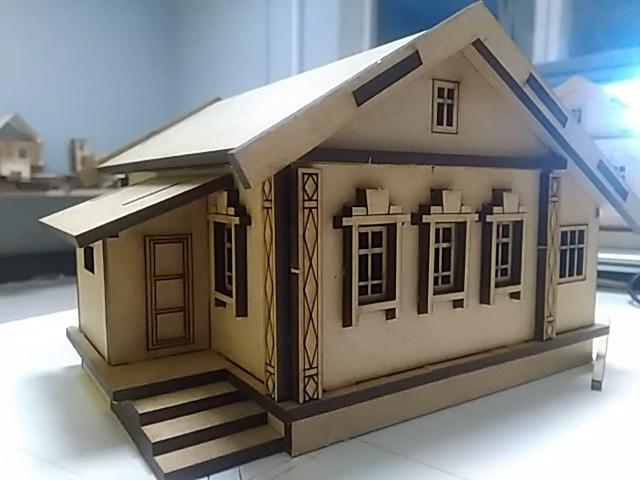 Laser Cut Wooden Village House Free Vector
