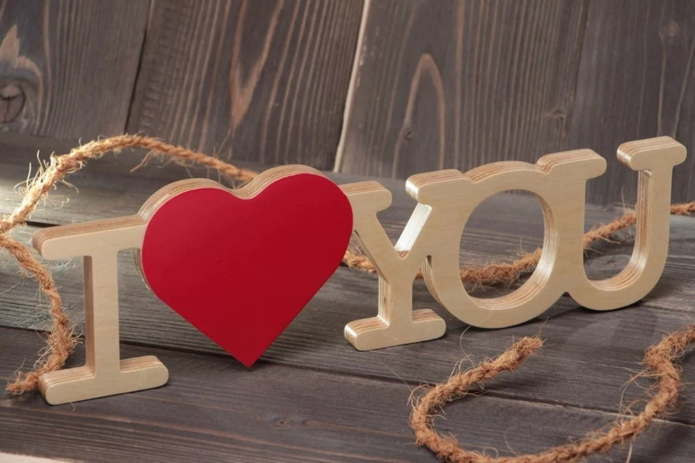 Laser Cut I Love You  Wooden Letters With Red Heart Shape On Stand Free Vector