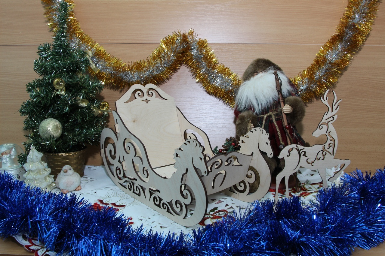 Laser Cut Wood Christmas Sleigh and Reindeer Free Vector