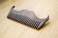 Laser Cut Mustache Shaped Comb Free Vector