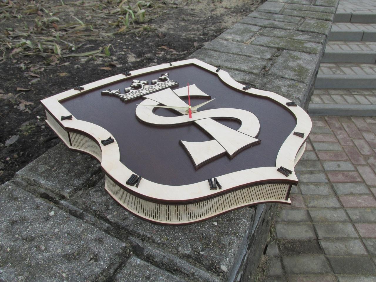 Laser Cut Emblem Design Clock Free Vector