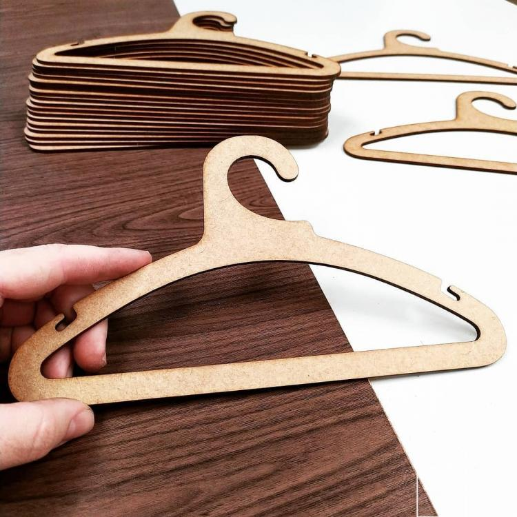 Laser Cut Contemporary Clothes Hanger Free Vector