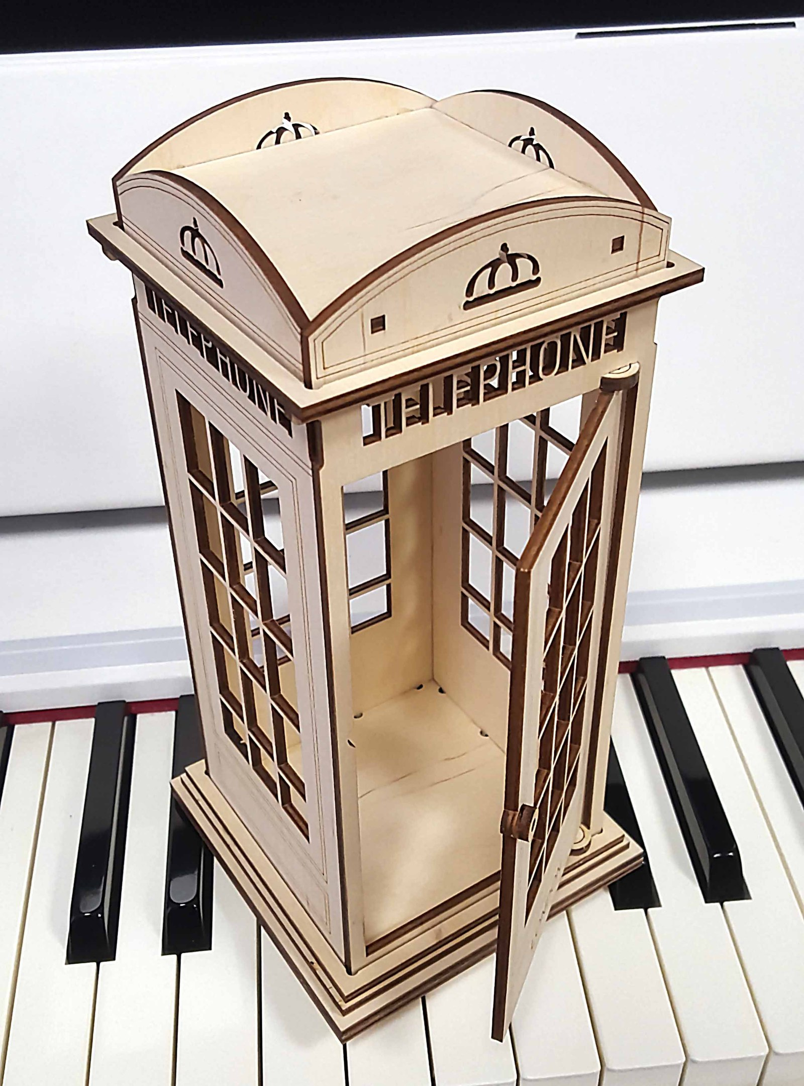 Laser Cut Wooden British Telephone Booth Free Vector