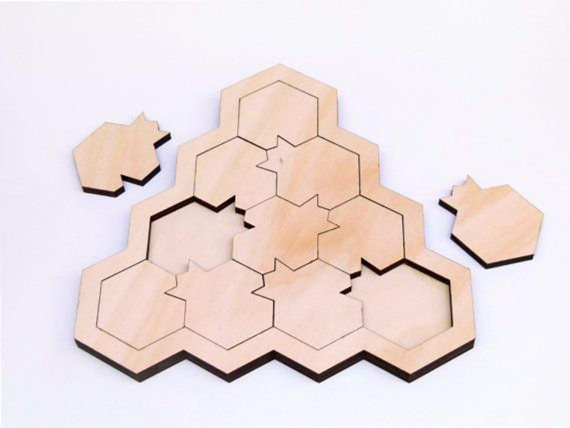 Laser Cut Pomegranate Puzzle Game Free Vector