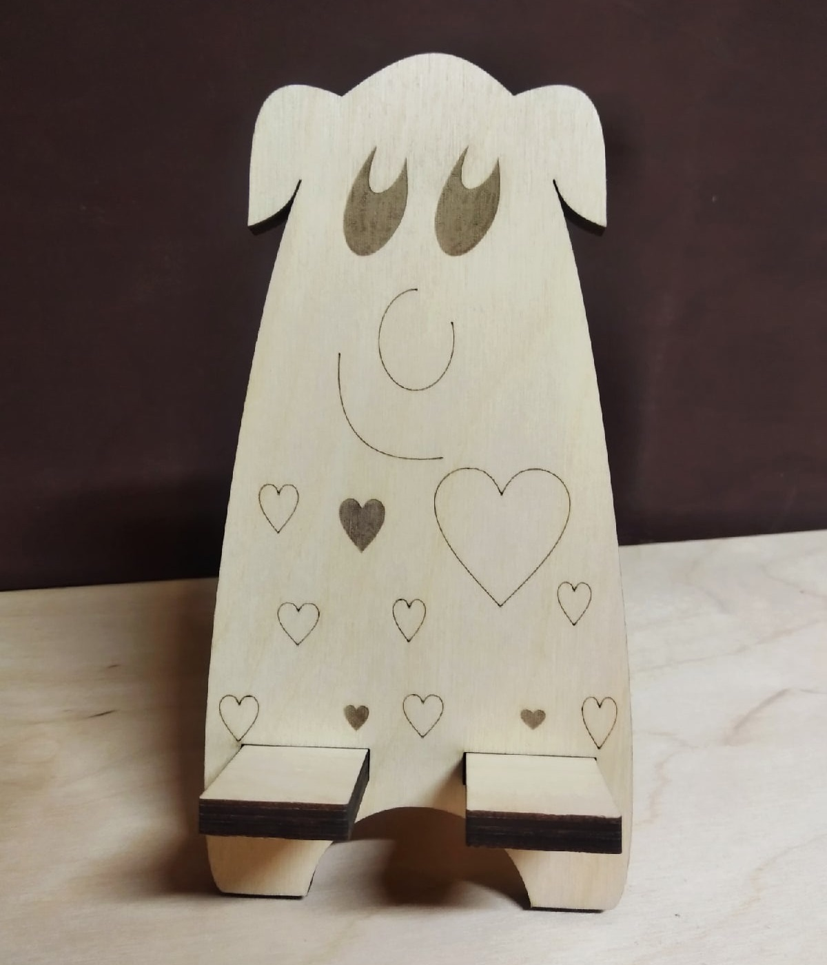 Laser Cut Wooden Cute Cell Phone Stand Free Vector