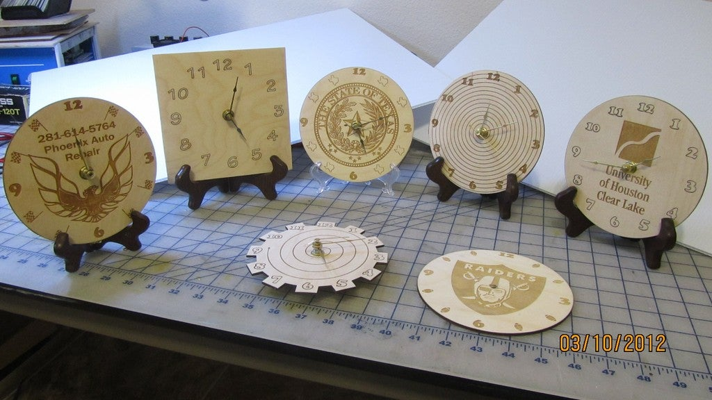 Laser Cut Engraved Wooden Clocks With Logos Free Vector