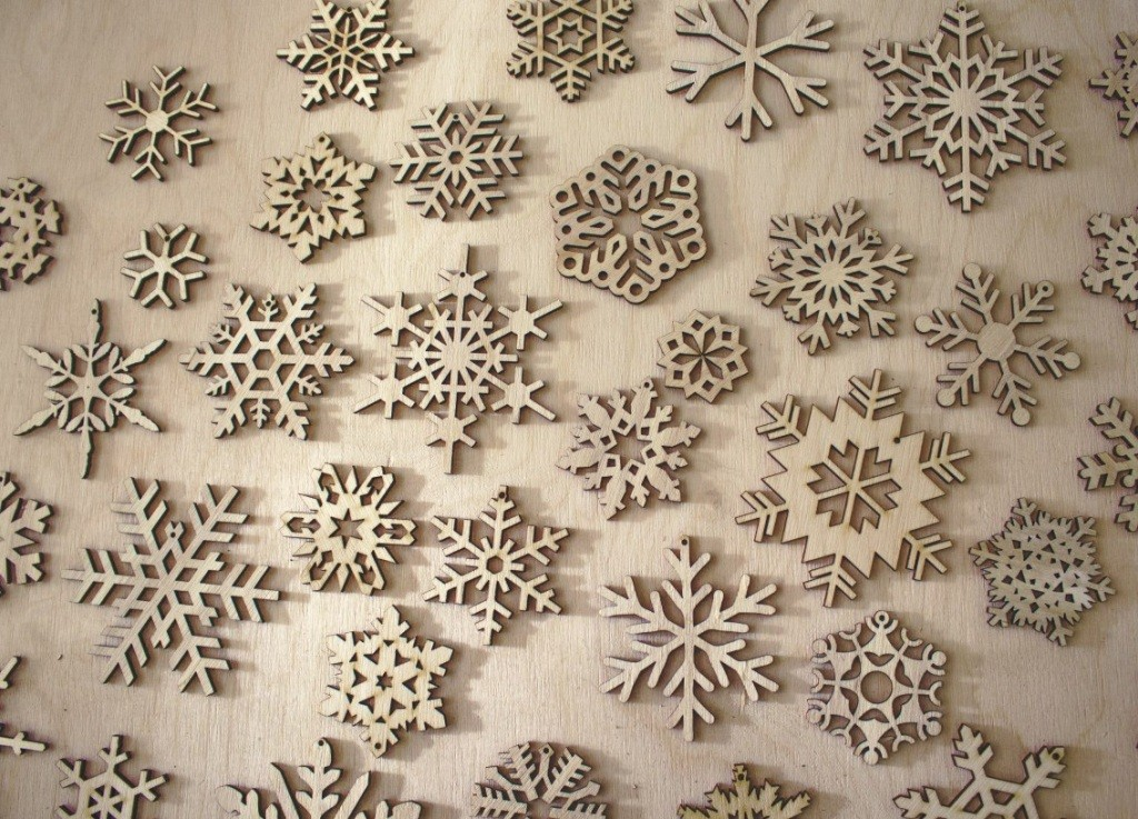 Laser Cut Wood Snowflake Ornaments Free Vector