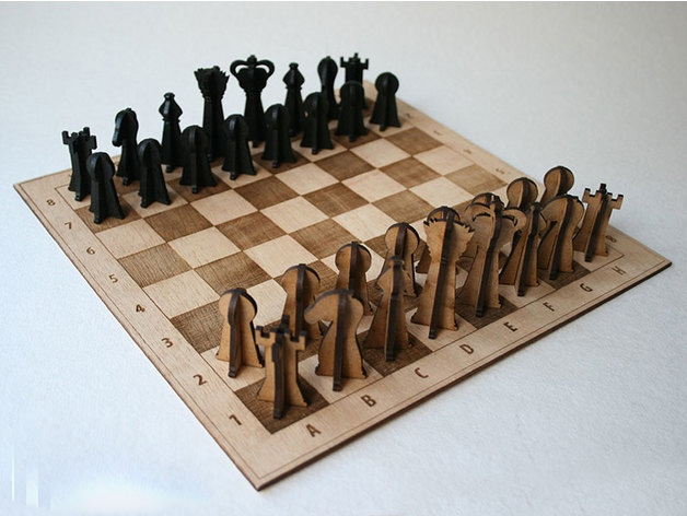 Laser Cut Wooden Chessboard And 3D Pieces Free Vector