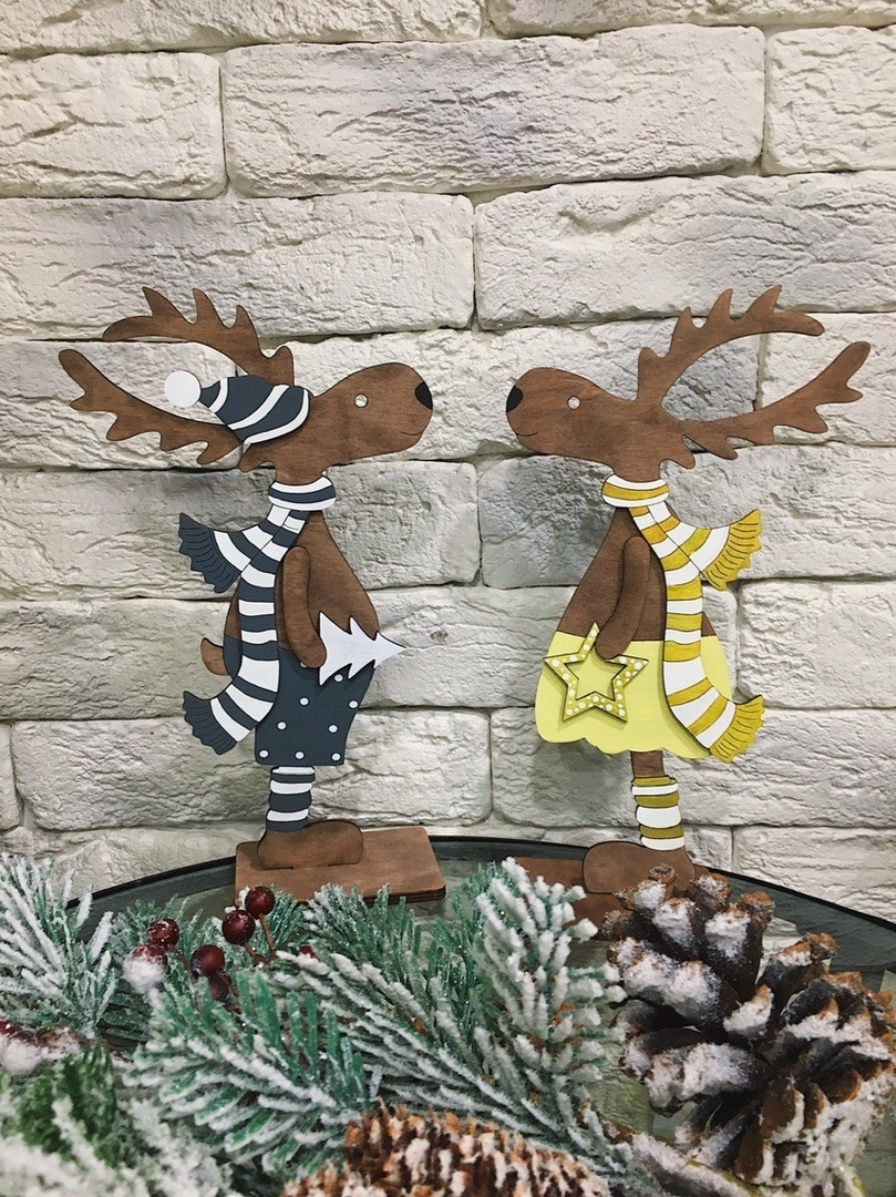 Laser Cut Christmas Deer Standing On A Stand Free Vector