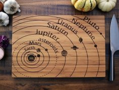 Laser Cut Planets Vector Art on Cutting Board Free Vector