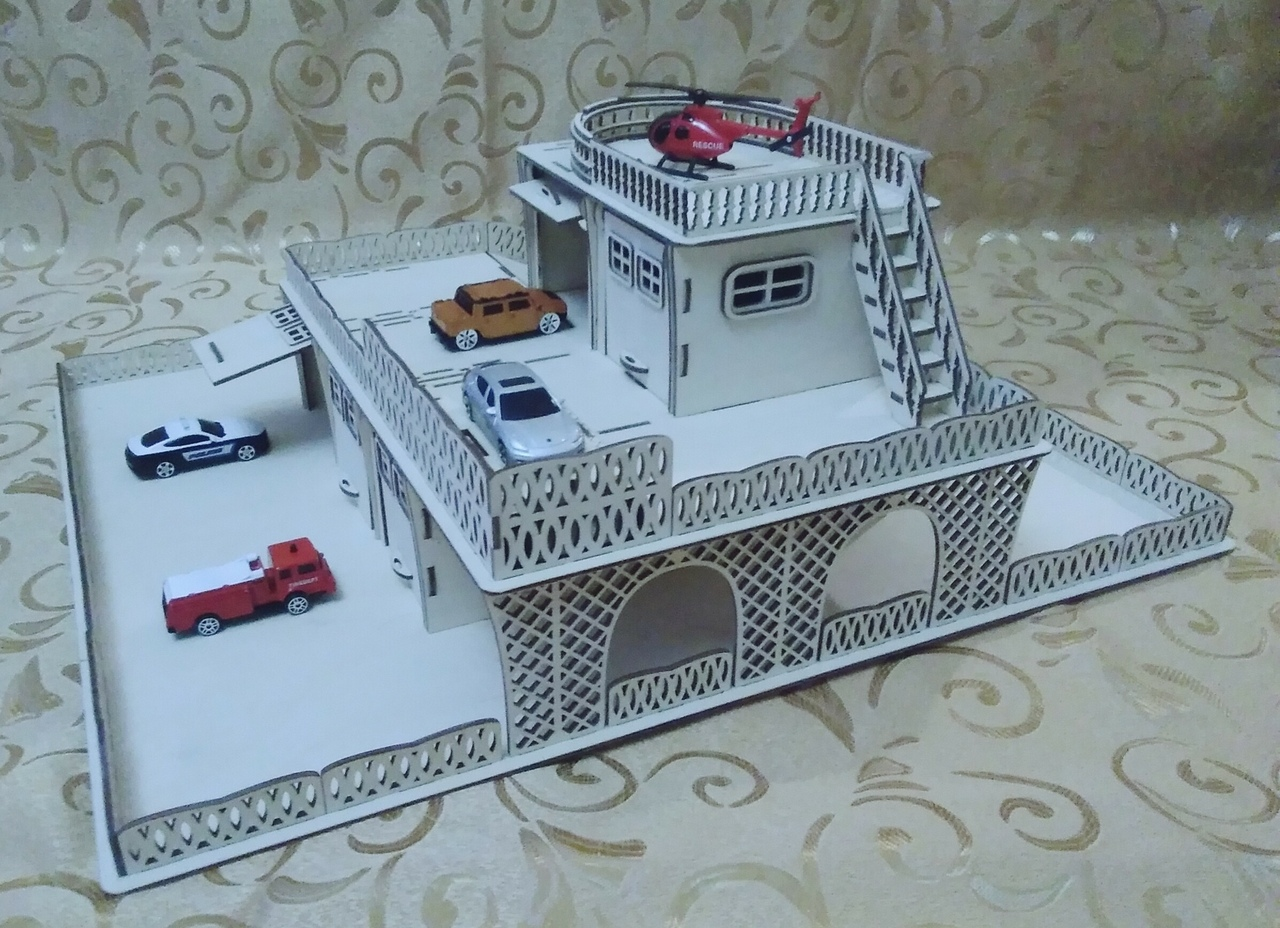 Laser Cut Wooden Toy Garage With Helicopter Deck Free Vector